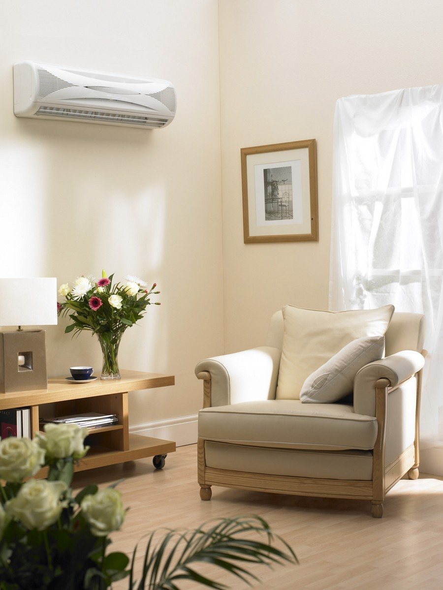 2-beige-living-room-interior-design-soft-arm-chair-console-flowers-air-conditioner