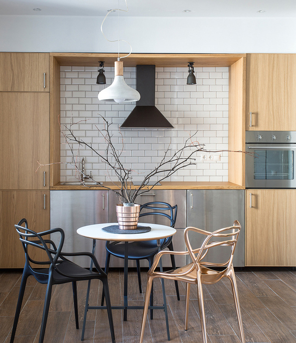 2-minimalist-style-studio-apartment-interior-design-open-concept-white-walls-kitchen-IKEA-set-wood-faced-recess-dining-table-chairs-by-Philippe-Starck-black-copper-brick-tiles-white