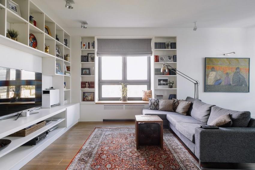 2-minimalist-style-white-walls-and-gray-apartment-interior-design-open-concept-living-room-big-shelving-unit-gray-corner-sofa-carpet-floor-lamp-roman-blinds-TV-set
