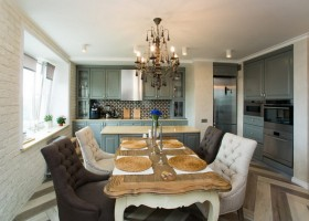 2-white-gray-brown-French-style-open-concept-living-dining-room-kitchen-interior-design-faux-brick-plaster-wall-island-set-chandelier-mismatched-chairs