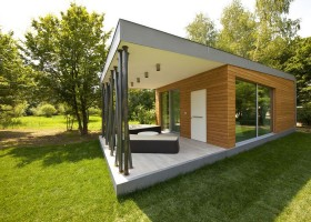 3-modern-minimalist-architecture-exterior-design-solar-eco-house-Italy-Green-Zero-Daniele-Menichini-panoramic-windows-open-terrace-metal-support-structures-lounge-sofas-coffee-table-beautiful-view-trees