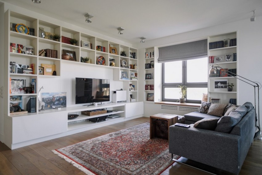 4-0-minimalist-style-white-walls-and-gray-apartment-interior-design-open-concept-living-room-big-shelving-unit-gray-corner-sofa-carpet-floor-lamp-roman-blinds-TV-set