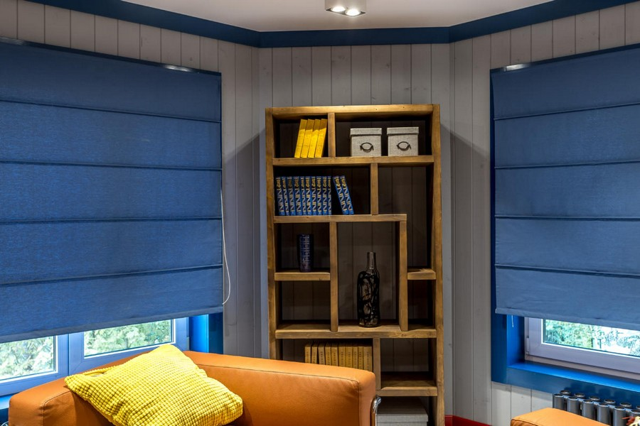 4-1-bright-yellow-orange-blue-attic-room-interior-design-wooden-boards-walls-geometrical-shelving-unit-painted-window-frame-Roman-blinds