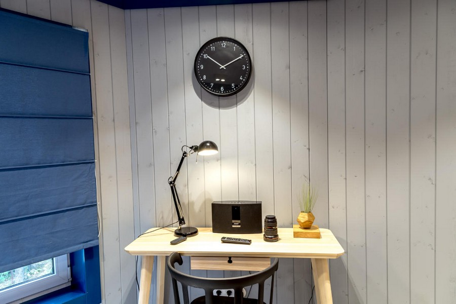 4-2-gray-and-blue-attic-work-area-room-interior-design-wooden-boards-walls-painted-window-frame-roman-blinds-clock-desk-hinged-desk-lamp