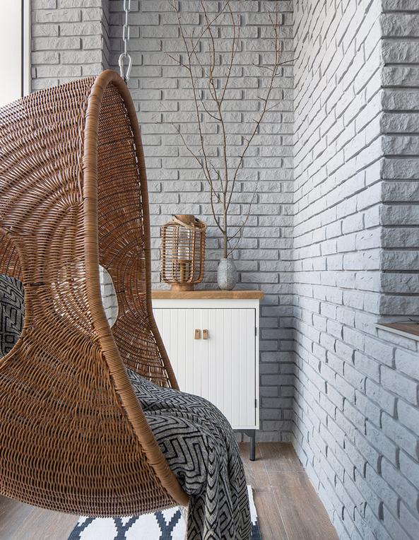 4-minimalist-style-balcony-interior-design-white-walls-clincker-bricks-suspended-wicker-arm-chair