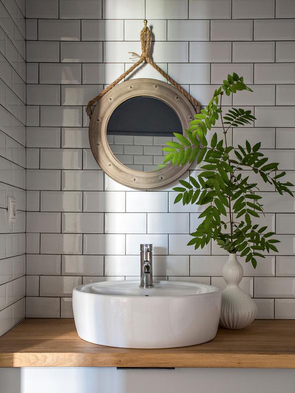 5-minimalist-style-bathroom-interior-design-wooden-countertop-white-brick-tiles-round-mirror-rope-tree-branch