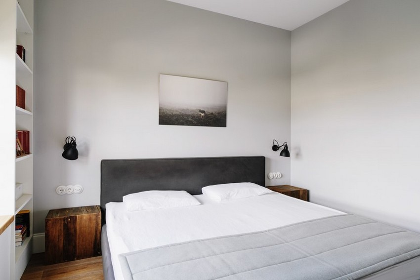 6-3-minimalist-style-white-walls-and-gray-apartment-interior-design-bedroom-photo-above-headboard-bed-rough-wooden-bedside-tables-nighstands