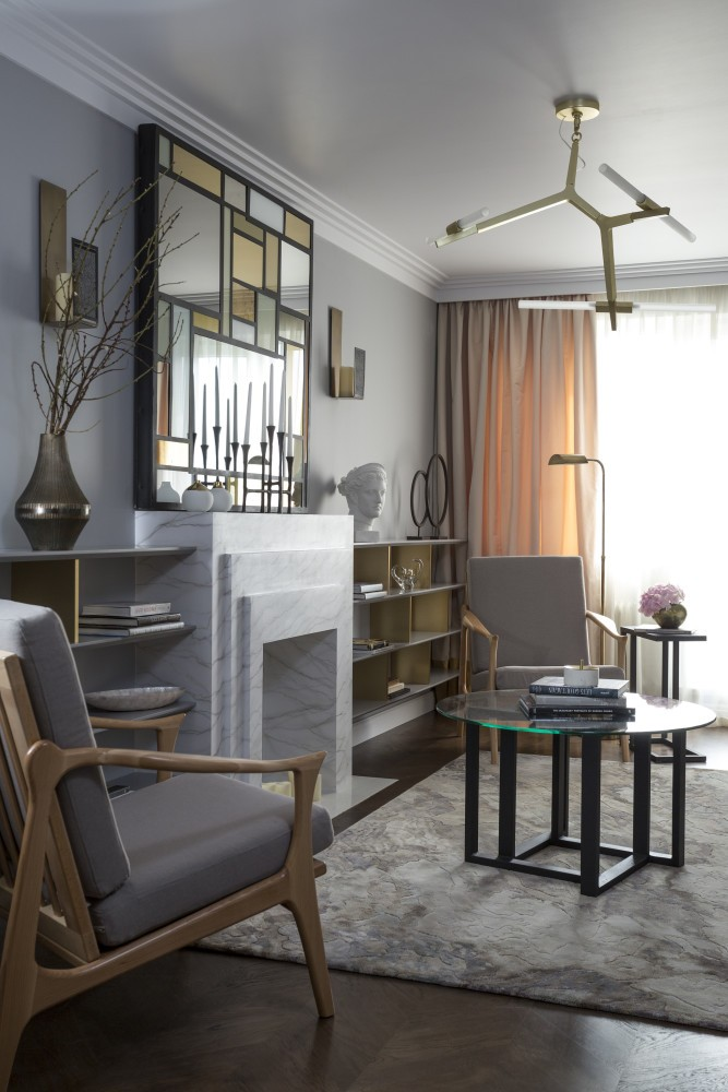 7-gray-pink-beige-French-style-living-room-home-library-interior-design-with-art-deco-elements-shelving-unit-arm-chairs-faux-fireplace-lamps-coffee-table-mirror-wall-decor-concealed-hidden-TV-set