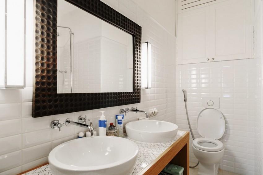 8-minimalist-style-white-walls-bathroom-interior-design-toilet-tiles-double-wash-basin-big-mirror-in-brown-frame