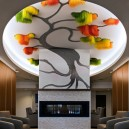 0-Sous-le-grand-arbre-racine-feuille-et-fleur-by-Elisabeth-Picard-CHSLD-Quebec-Canada-lobby-interior-tree-shaped-art-installation-ceiling-decor-gradient-ombre-effect-plastic-metal-aluminum-LED-lights-green-yellow-orange