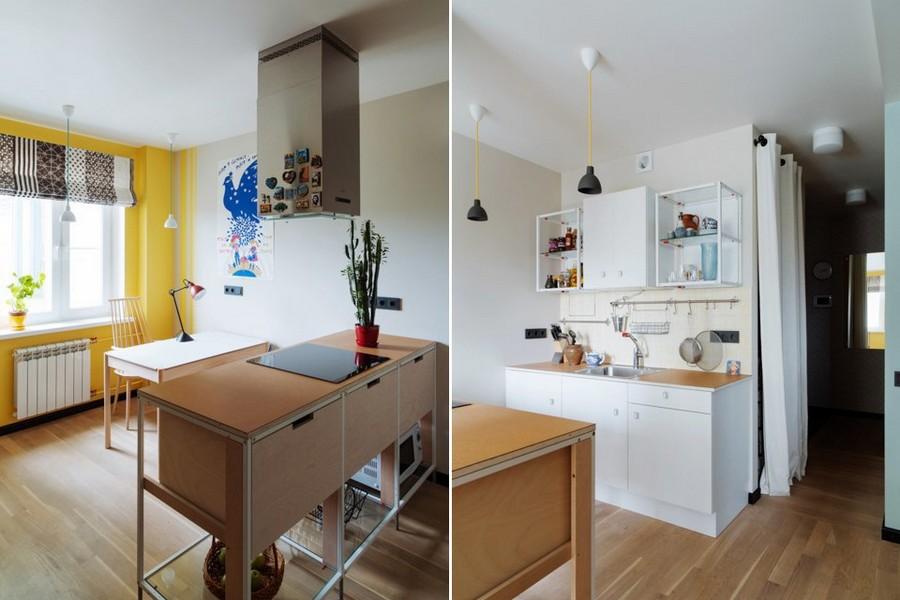 1-1-bachelor's-interior-design-open-concept-kitchen-dining-room-light-blue-walls-yellow-accents-island-black-pendant-lamps-sockets-cooker-hood-desk-lamp