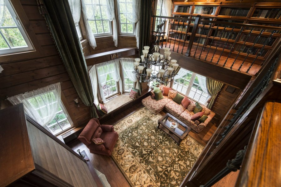 1-1-log-timber-wooden-house-interior-design-walls-big-panoramic-windows-overdrapery-drapery-sheer-curtains-gallery-open-to-below-second-floor-floral-sofa-green-pink-brown-living-room-lounge-windowsill