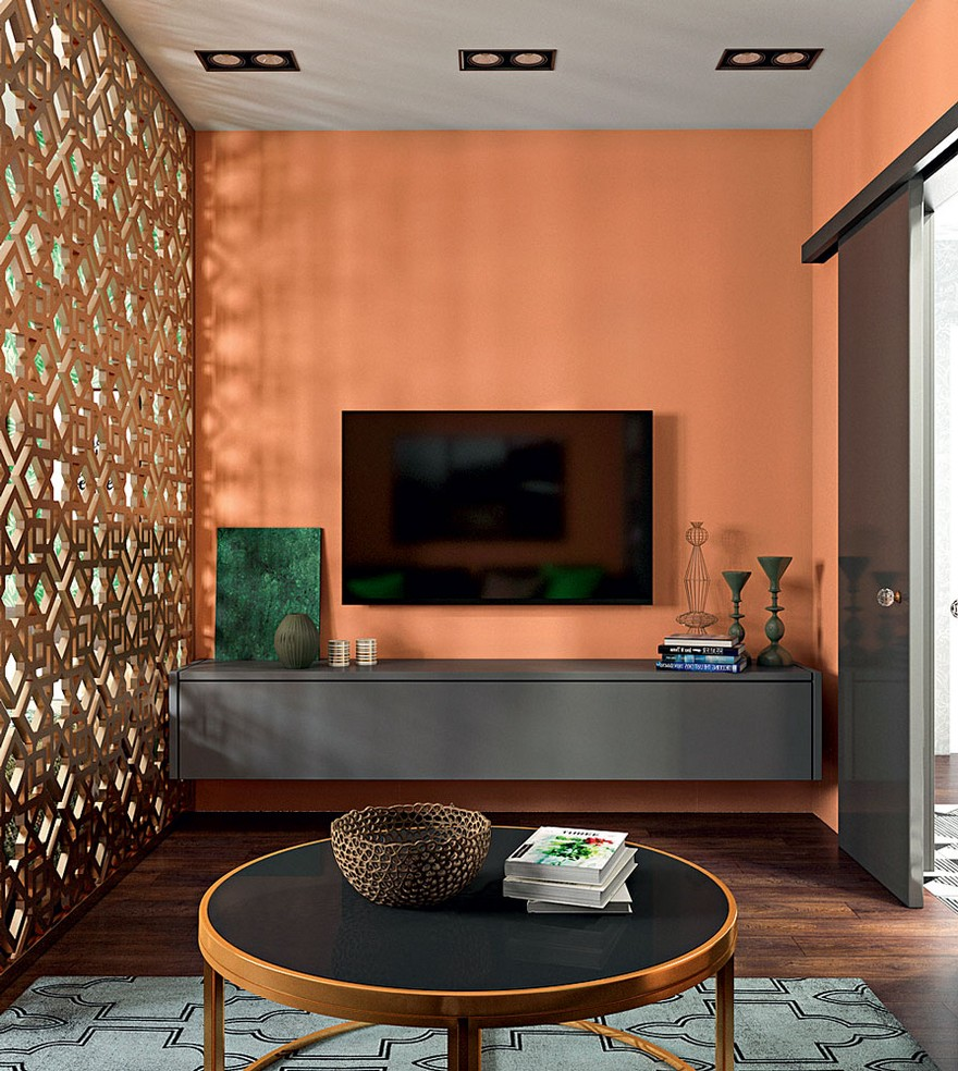 1-3-contemporary-style-interior-design-living-room-lounge-perforated-screen-room-divider-round-metal-coffee-table-Eichholtz-chocolate-brown-parquetry-orange-wall-geometrical-carpet-TV-set-suspended-console
