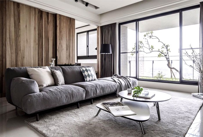 1-contemporary-minimalist-naturalistic-style-interior-design-white-walls-glossy-floor-gray-black-beige-accents-wooden-wall-panels-wood-grain-rug-sofa-living-room