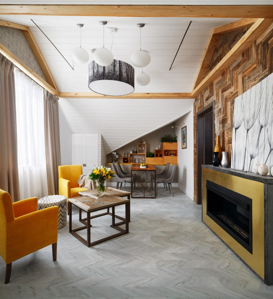 1-contemporary-style-attic-interior-metal-and-concrete-bio-fireplace-sloped-ceiling-white-walls-wooden-wall-decor-yellow-arm-chairs-living-room-coffee-table-dining-area-naturalistic-corkwood-floor-faux-beams