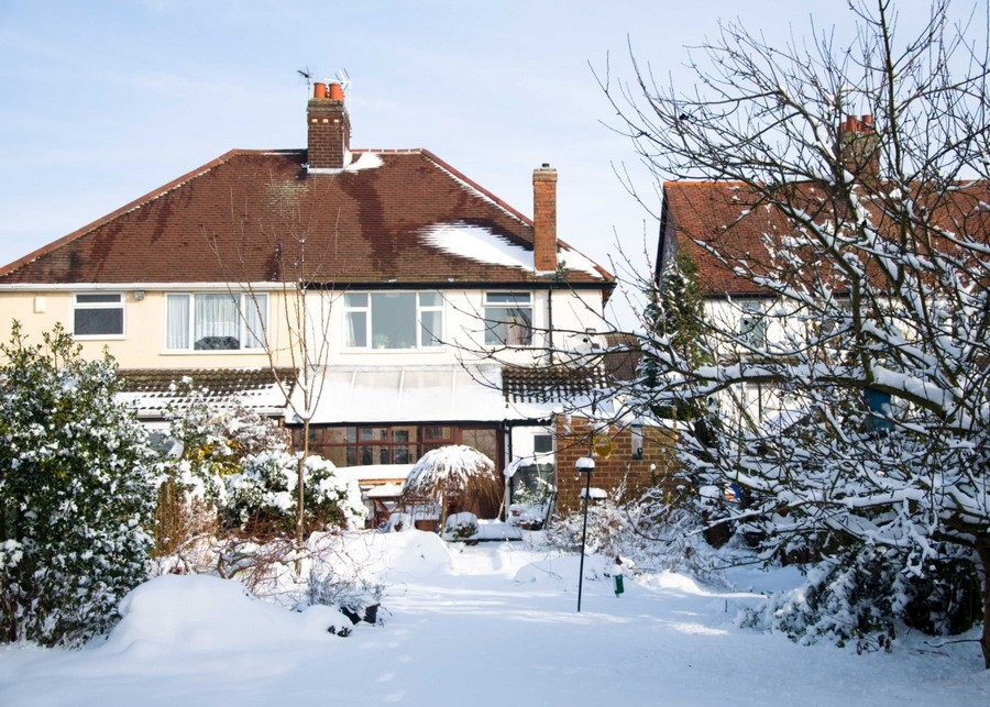 1-garden-covered-with-snow-house-sunny-day