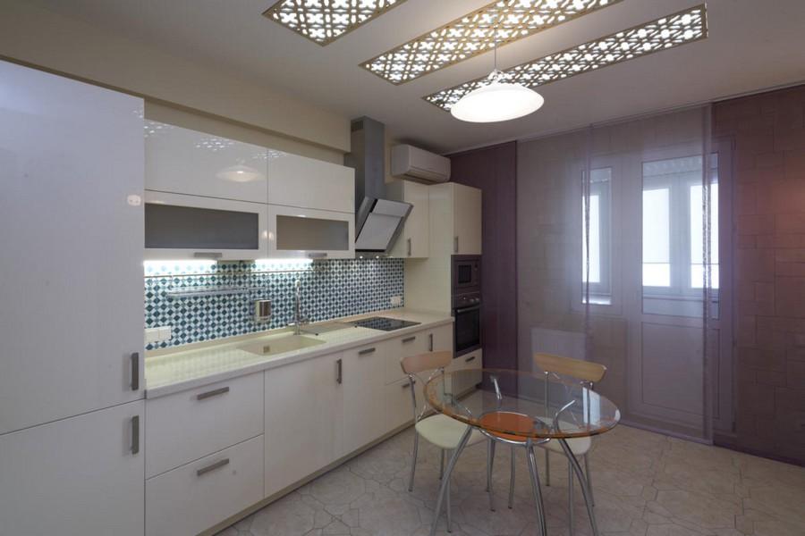2-1-beautiful-creative-kitchen-backsplash-ideas-blue-and-white-wall-tiles-Almeria-Emeraude-Spain-white-cabinets-glass-dining-table-interior-design