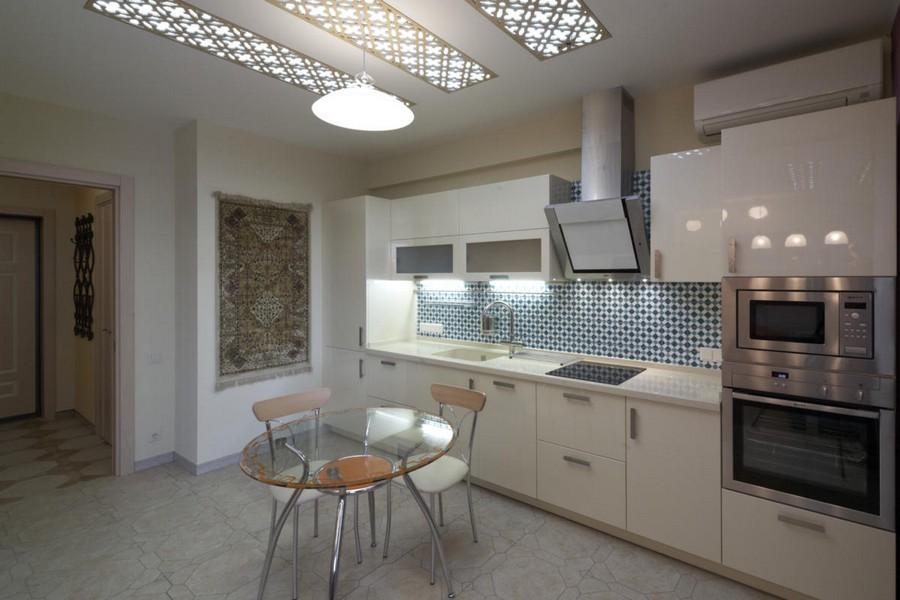 2-2-beautiful-creative-kitchen-backsplash-ideas-blue-and-white-wall-tiles-Almeria-Emeraude-Spain-white-cabinets-glass-dining-table-interior-design