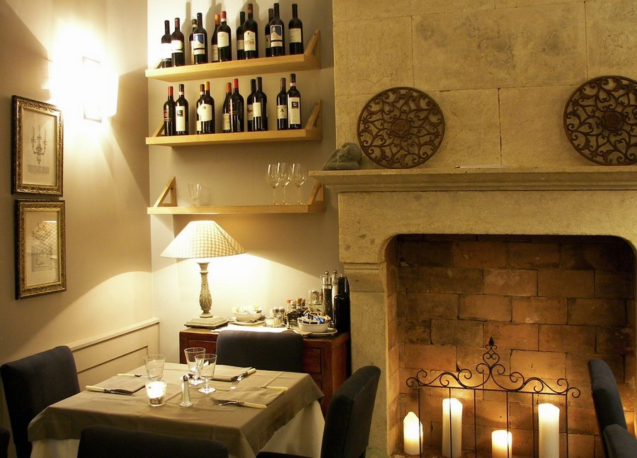 2-3-Convivium-restaurant-cafe-bar-in-Milan-Italy-interior-design-traditional-style-gray-blue-beige-elegant-faux-fireplace-candles-wine-racks-desk-lamp
