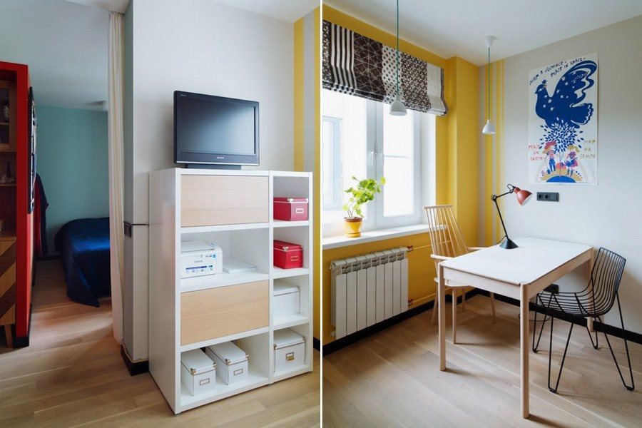 2-bachelor's-interior-design-open-concept-kitchen-bedroom-light-blue-walls-yellow-red-accents-roman-blinds-black-sockets-chest-of-drawers-dining-table-Hay-oak-parquet-floor