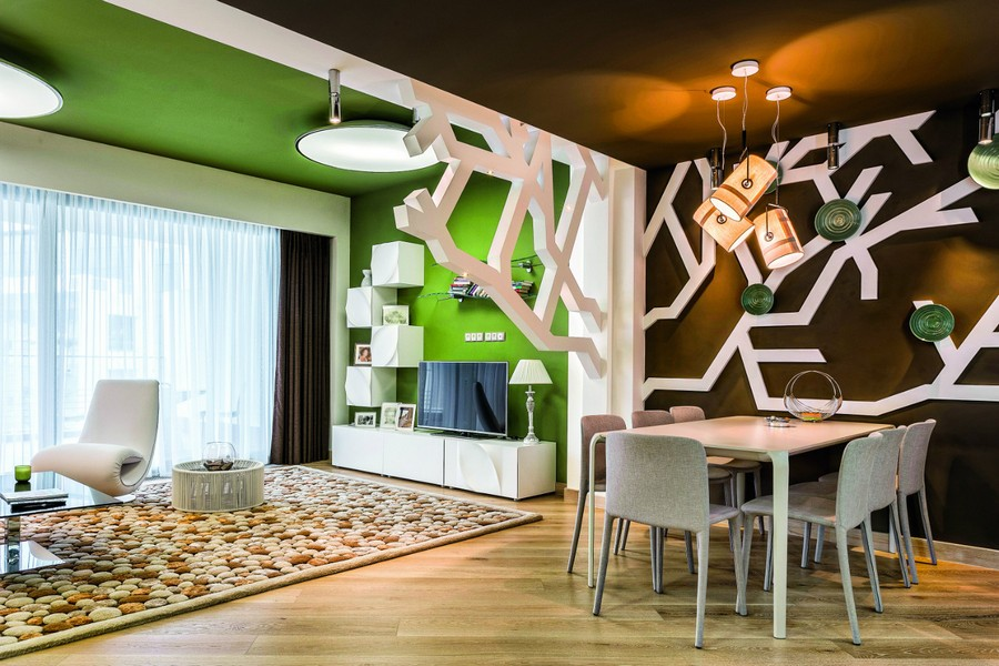 2-contemporary-style-open-concept-living-room-dining-lounge-kitchen-interior-design-plasterboard-sheetrock-3D-wall-decor-tree-branches-green-ceiling-fitting-brown-wall-white-3D-cabinets-table-gray-chai