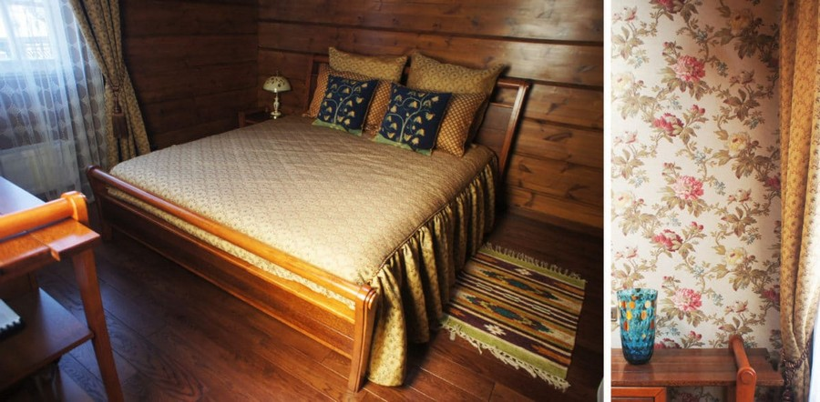 3-3-log-timber-wooden-house-bedroom-interior-design-brown-walls-sloped-ceiling-skylights-sheer-curtains-draped-bedspread-beige-blue-throw-pillows-bed-cover-bedspread-with-cord-trim-floral-wallpaper