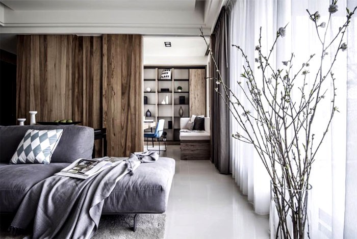 3-contemporary-minimalist-naturalistic-style-interior-design-white-walls-glossy-floor-gray-black-accents-wooden-panels-wood-grain-sliding-door-study-living-room