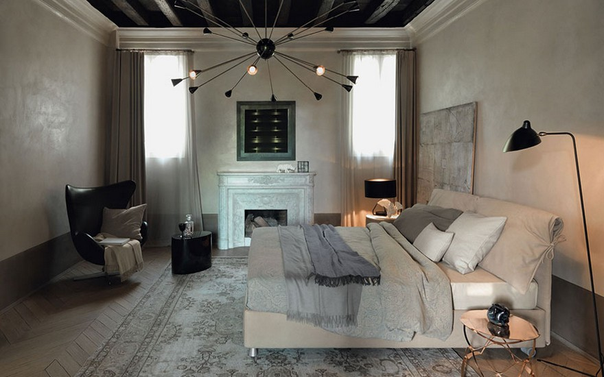 3-eclectic-style-bedroom-vintage-fireplace-herringbone-pattern-parquet-floor-contemporary-upholstered-bed-black-floor-lamp-art-deco-chandelier-arm-chair-carpet