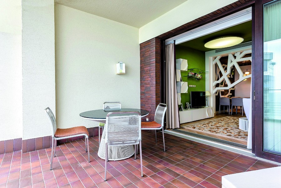 3-recessed-balcony-design-open-terrace-round-table-chiars-purple-red-floor-tiles-lounge-exit
