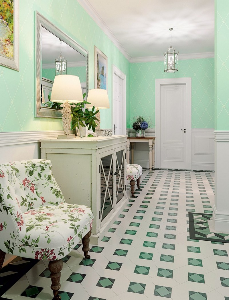4-Provence-style-entry-room-corridor-interior-design-white-walls-floral-motifs-pattern-arm-chair-upholstery-geometrical-floor-tiles-green-walls-paneling-console-mirror-crossed-boiserie