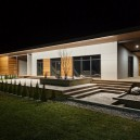 5-1-Nota-Bene-Minsk-minimalist-modern-archietcture-one-floor-frame-house-narrow-elongated-flat-roof-laconic-Scandinavian-style-larch-wood-and-concrete-terrace-panoramic-windows-thujas