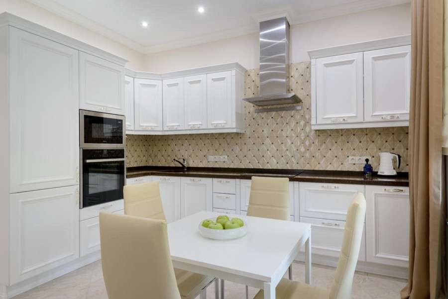 5-1-beautiful-creative-kitchen-backsplash-ideas-traditional-style-white-cabinets-beige-capitone-pattern-effect-dining-table-chairs-brown-countertop-interior-design