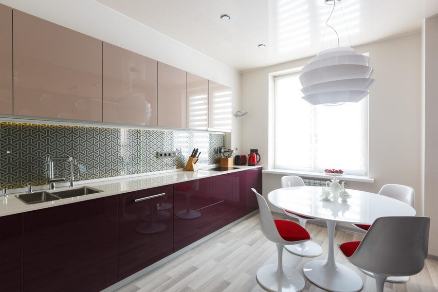 7-2-beautiful-creative-kitchen-backsplash-ideas-beige-and-purple-glossy-cabinets-metalized-TRIFID-wallpaper-Osborne-&-Little- protected-by-tempered-glass-white-dining-table-round-chairs-pendant-lamp-gray-floor
