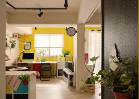 7-2-studio-apartment-design-light-floating-wood-floor-track-lights-beige-walls-red-blue-yellow-accents-shelving-unit-perforated-wall-board-flower-pots-work-area-computer-desk-chairs-clock