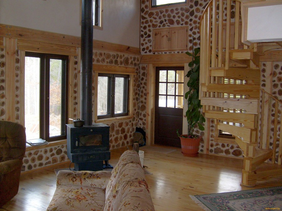 9-cordwood-technology-technique-eco-friendly-house-construction-building-interior-fireplace-stove-staircase-living-room
