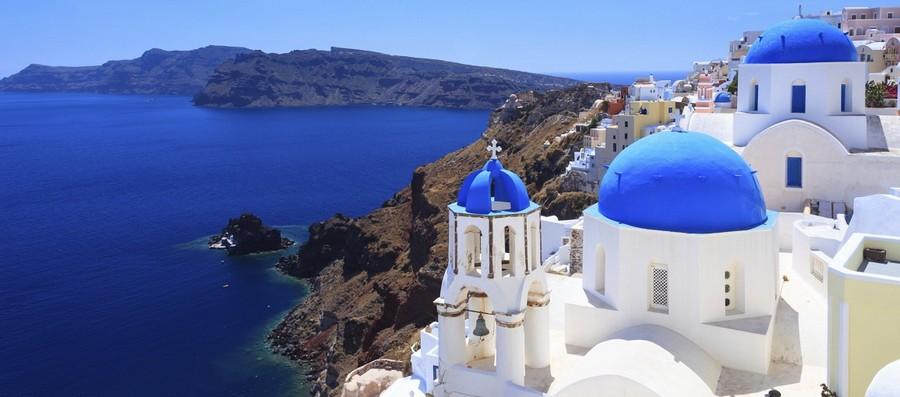 0-Santorini-island-Greece-pure-white-houses-church-with-blue-roof-mountains-sea-shore-the-Aegean-sea