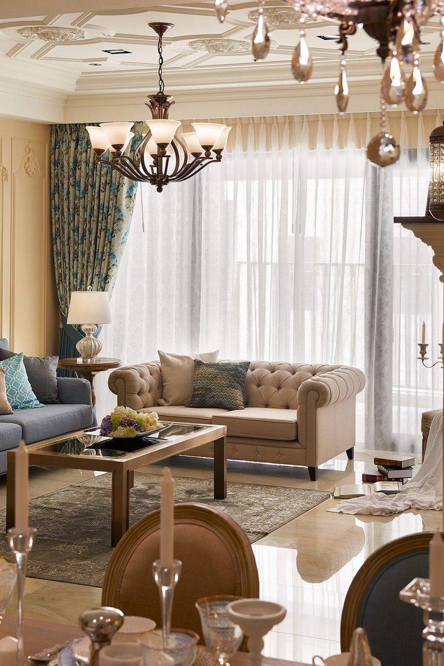 0-neo-classical-style-interior-neutral-beige-blue-Tuscan-colors-living-room-wall-moldings-ceiling-medallions-contemporary-furniture-chester-sofa-coffee-table-floral-curtains-chandelier-tiles