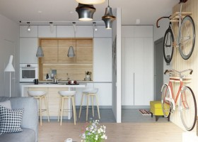 00-contemporary-style-studio-apartment-interior-design-open-concept-kitchen-entry-living-room-island-bicycle-wall-mounted-racks-light-wood-strips-bar-stools-white-cabinets-yellow