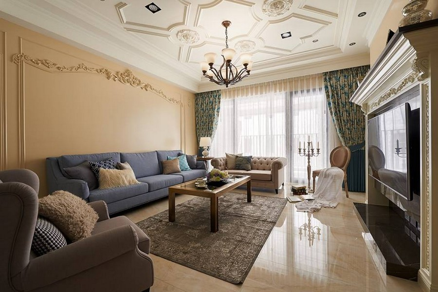 1-1-neo-classical-style-interior-neutral-beige-blue-Tuscan-colors-living-room-wall-moldings-ceiling-medallions-contemporary-furniture-sofa-coffee-table-floral-curtains-rug-chandelier-tiles