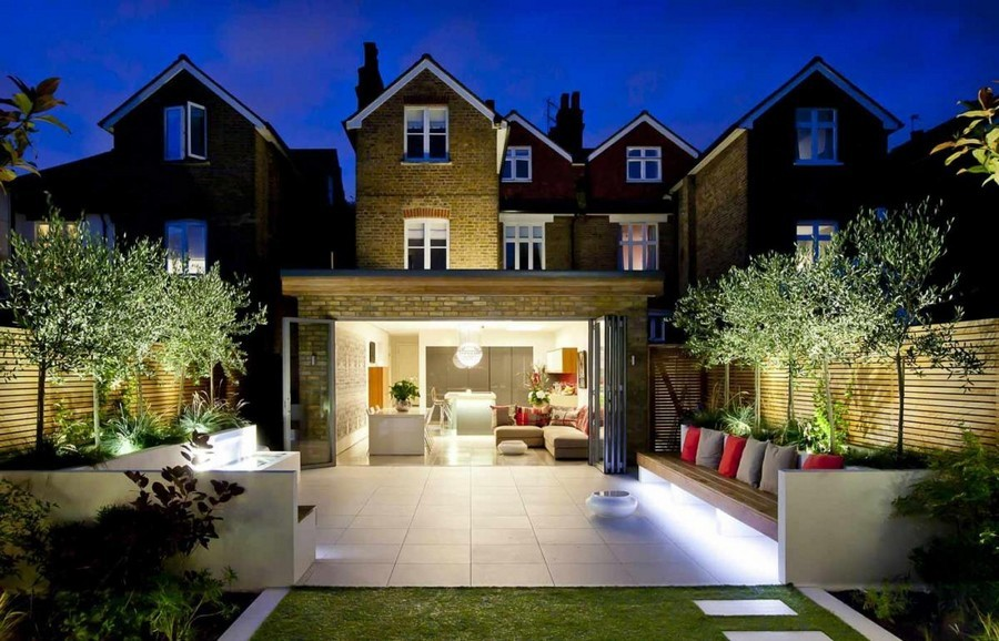 1-5-outdoor-garden-landscape-lighting-ideas-spotlighting-plants-trees-uplights-in-ground-big-open-terrace-seating-area-bench-pillows