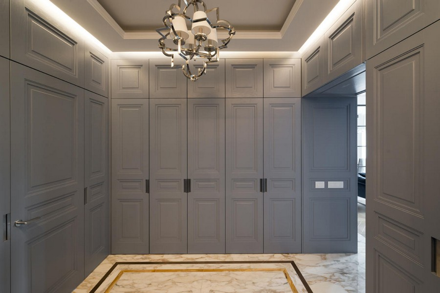 1-American-style-interior-wooden-panelling-closets-blue-invisible-doors-hallway-entrance-hall-entry-room-white-marble-floor-tiles