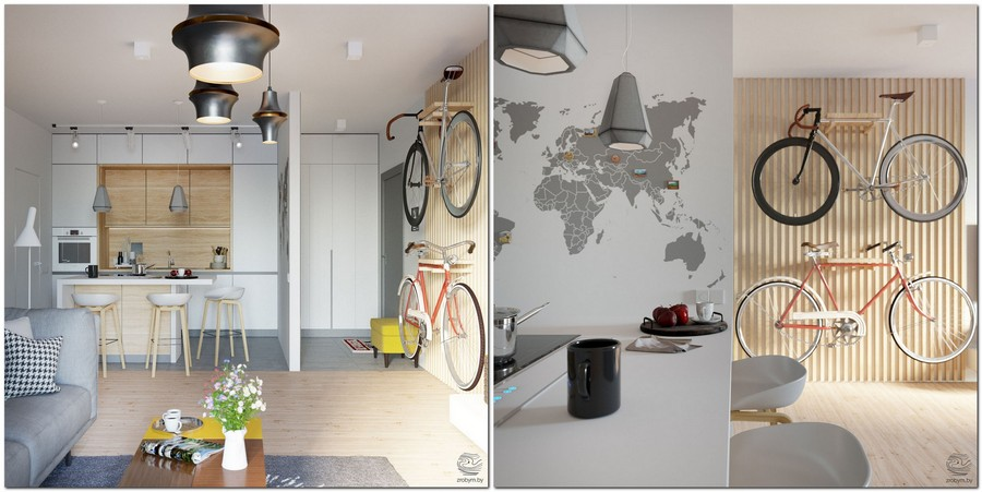 1-contemporary-style-studio-apartment-interior-open-concept-kitchen-entry-living-room-island-bicycle-wall-mounted-racks-light-wood-strips-bar-stools-white-cabinets-yellow-world-map