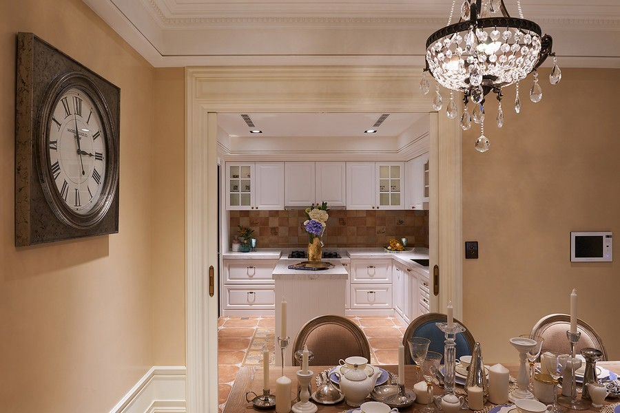 3-0-neo-classical-style-interior-neutral-beige-blue-Tuscan-colors-open-concept-dining-room-kitchen-island-white-cabinets-square-tiles-Italian-backsplash-wall-clock-chandelier-crystal
