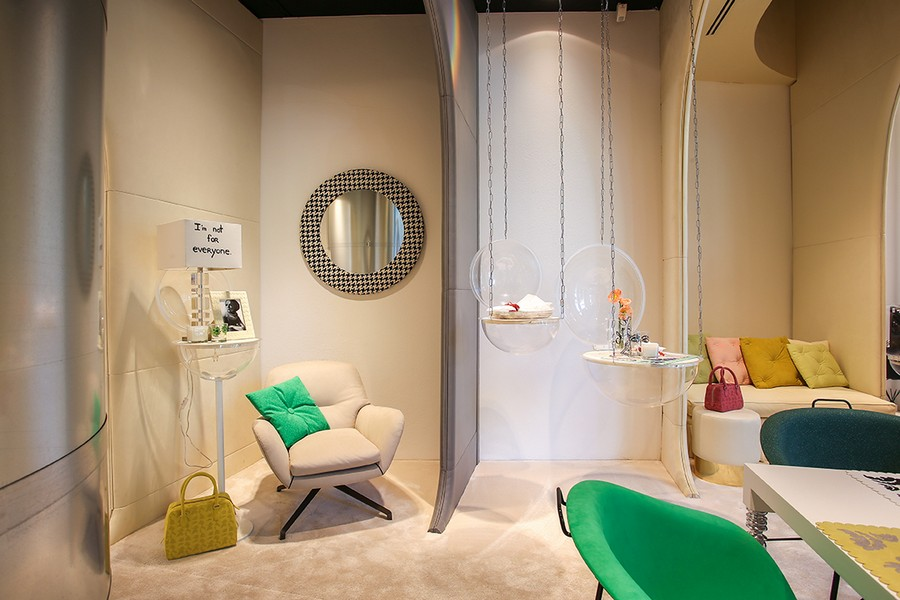 3-1-new-show-room-concept-store-in-Milan-Italy-2017-Alcantara-material-collection-in-interior-design-sofa-upholstery-fabric-mint-green-arm-chair-mirror-phot-frame-purse-hand-bag-throw-pillows