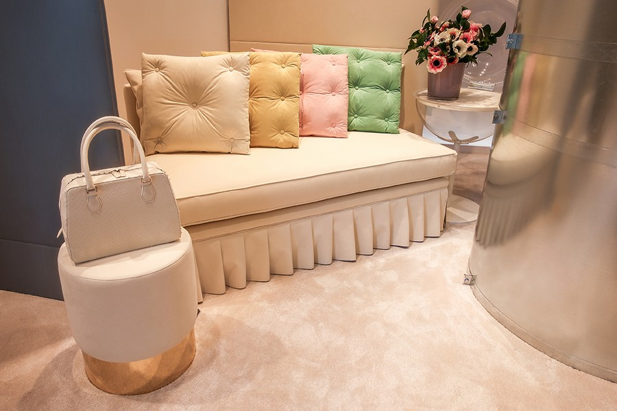 3-2-new-show-room-concept-store-in-Milan-Italy-2017-Alcantara-material-collection-in-interior-design-sofa-with-ruffles-beige-capitone-throw-pillows-couch-pale-pastel-pink-mint-green-yellow-beige-bag-purse