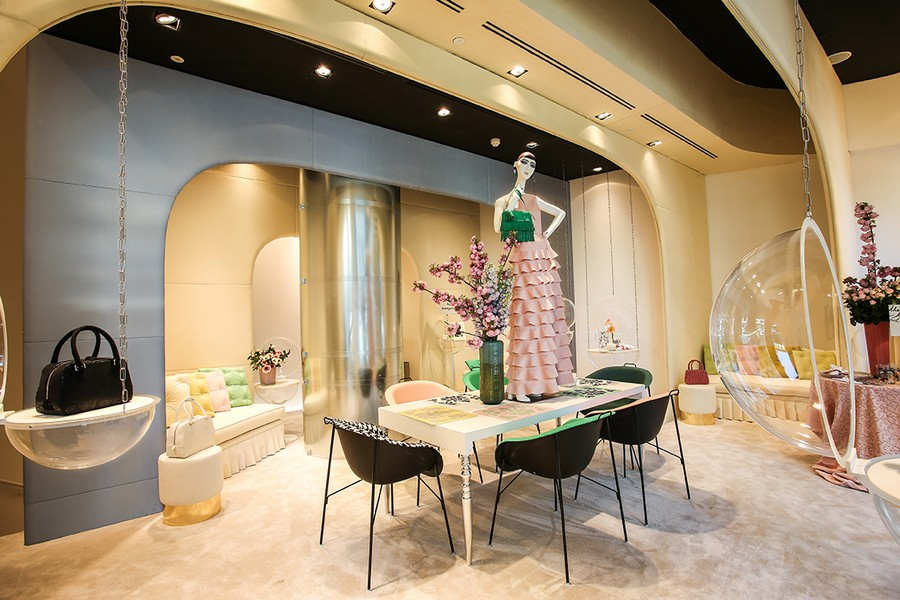 4-1-new-show-room-concept-store-in-Milan-Italy-2017-Alcantara-material-collection-in-interior-design-lounge-living-room-dining-table-chairs-upholstery-fabric-sofa-couch-throw-pillows-mannequin-hand-bags-purses