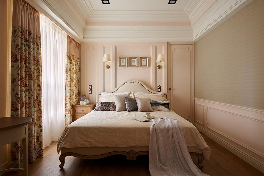 4-2-neo-classical-style-interior-neutral-beige-blue-Tuscan-colors-bedroom-upholstered-bed-with-rivets-wall-panels-moldings-nightstand-wall-lamps-sconces-throw-pillows-floral-curtains-green