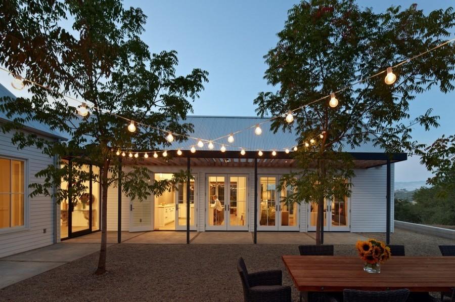 4-5-outdoor-garden-landscape-lighting-ideas-rope-string-holiday-lights-bulbs-patio-between-trees
