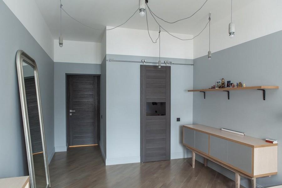 5-4-bachelor's-interior-design-loft-style-brutal-bedroom-interior-design-gray-walls-dark-brown-doors-full-length-mirror-console-light-laminate-floor-industrial-lamp-exposed-bulbs-wires