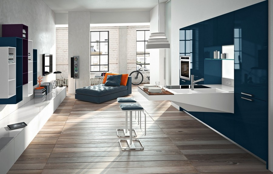 5-Snaidero-Italy-petroleum-bright-blue-kitchen-cabinets-set-interior-open-concept-studio-apartment-bar-table-stools-living-room-folding-bed-white-brick-walls-wooden-floor